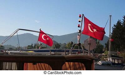 Turkish flags waving on board