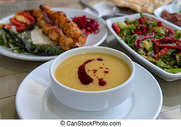 Turkish food dinner with soup and salad - Lental soup, ...