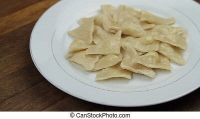 Turkish homemade manti, with potato and buttery ( Hingel -...