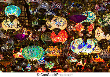 A lot of turkish glass lamps in small souvenir store.