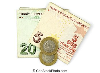 Turkish lira coins and folded notes isolated on white background.