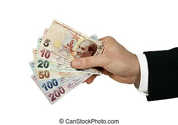 turkish lira in businessman's hand