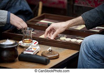 Turkish men playing backgammon