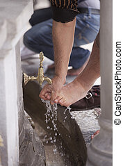 Turkish Muslim Man washing Feet