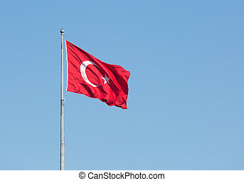 Turkish national flag on a background of blue sky