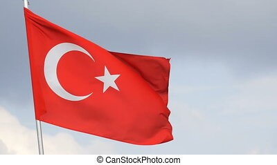 Turkish National flag waves in the wind against sky