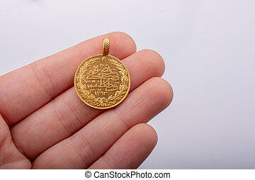 Turkish Ottoman style gold coin in hand