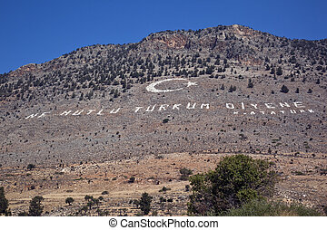 Turkish Republic of Northern Cyprus - Ataturk quotation on a hillside that overlooks the disputed border to the southern (Greek) side of Cyprus.