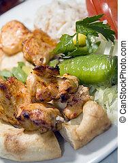Turkish shish kebab rice green pepper pita bread plate