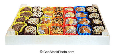 Turkish sweets, candies in a wooden box on the white background,