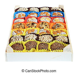 Turkish sweets, candies in a wooden box on the white background