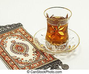Turkish tea with traditional turkish carpet