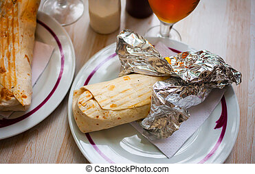Traditional turkish Durum with meat, vegetables and sauce in lavash flatbread