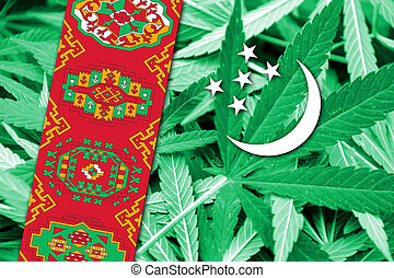 Turkmenistan Flag on cannabis background. Drug policy....