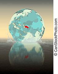 Turkmenistan on globe splashing in water