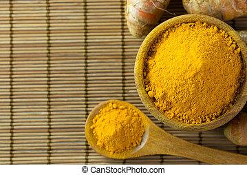 Turmeric powder - Close up of turmeric powder on bamboo mat