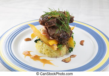 Turmeric rice junior beef short ribs with rice on plate