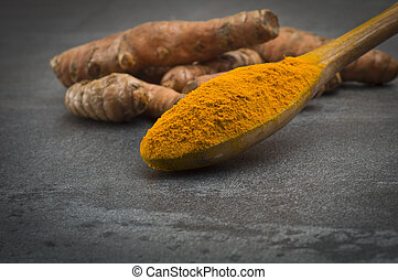 turmeric root and some slices - dust of ground turmeric on ...