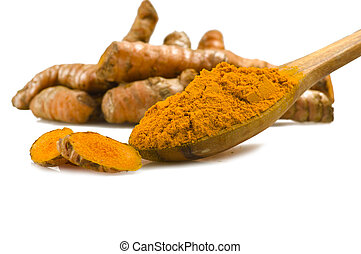 turmeric root slices and powder - dust of ground turmeric on...