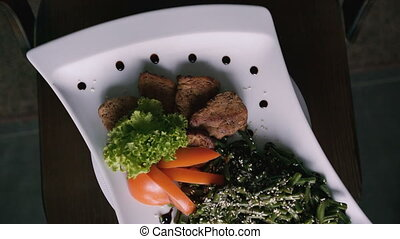 Turn around dish of meat and vegetables on the plate
