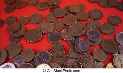 Movement around the euro coins on the red table