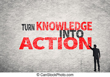 Turn Knowledge Into Action - Asian business man write words...