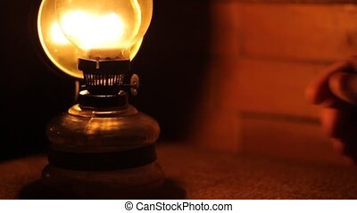 Turn off Gas Lamp - Person is turning of old petrol lamp, in...