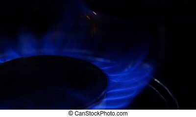 Turn on a stove. Close up. Slow motion
