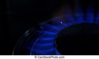Turn on gas burner. Close up. Slow motion