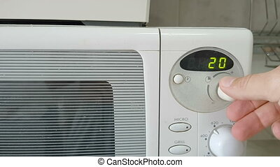 Turn on the microwave to heat food for lunch. - Turn on the...