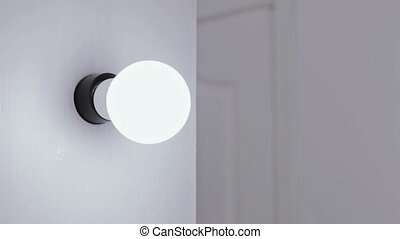 Turn on - turn off studio bulb - Studio bulb being turned on...