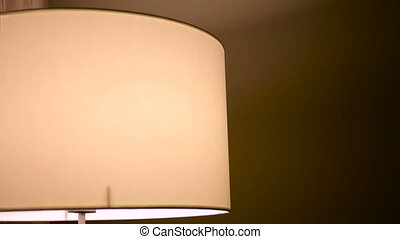 Turn On - Turn Off Table Lamp - yellow round light bulb in a...