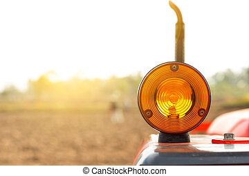 Turn Signal for Tractor on field backround.