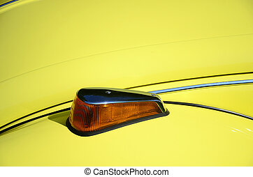 Turn Signal - Isolated turn signal on a yellow car.