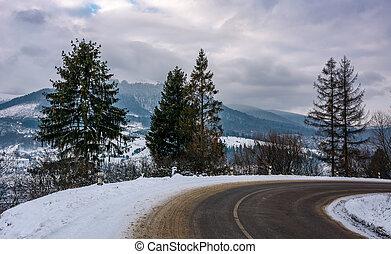 turnaround on serpentine in winter mountains
