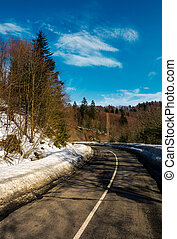 turnaround on the mountain road in winter. forested hills...