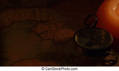 Turnaround view of the compass and the candle