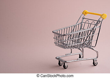 Turned pushcart empty on pale pink background, Black Friday concept.
