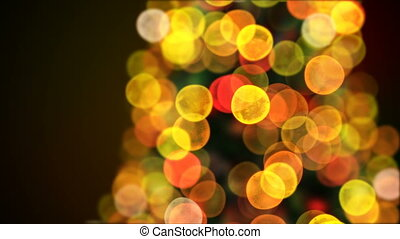 Turning Christmas Tree Lights Flickering Close-up in Blur Bokeh. Looped 3d Animation. Animated Greeting Card. Merry Christmas and Happy New Year Concept. 4k Ultra HD 3840x2160