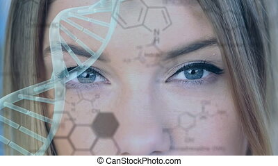 Turning DNA strand with face in the background
