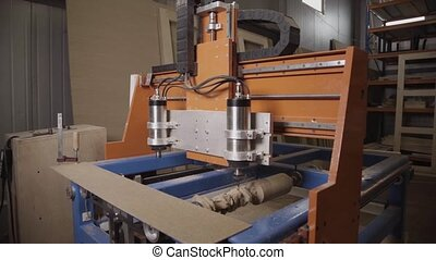 Turning lathe handles wooden block in furniture factory