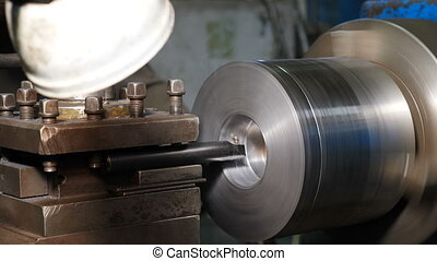 Turning lathe in action. Old turning lathe machine in ...