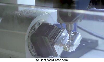 Turning milling machine cutting metal workpiece at factory