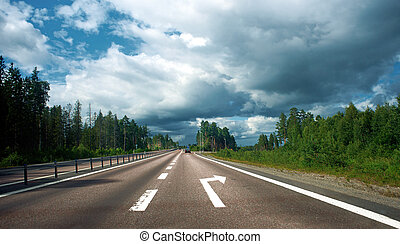 Turning off the highway - Highway with arrow sign for...