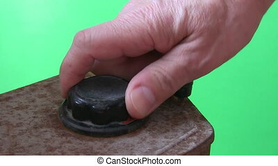 Turning old knob - Close up of a hand turning creaking black...