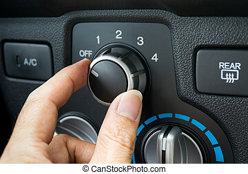 Turning on car air conditioning system