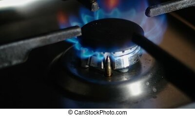 Turning on the cooktop gas cooker. Natural gas inflammation...