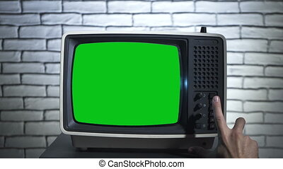 Video of retro tv with analog television on wall background