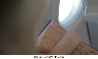 Turning Pages of a Travel Passport