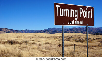 Turning Point Just Ahead brown road sign